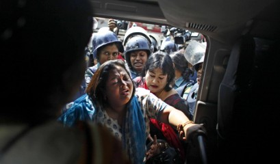 Four women lawmakers of BNP are being picked up on a police van after their arrest from in front of BNP headquarters at Nayapaltan. Photo: Rashed Sumon