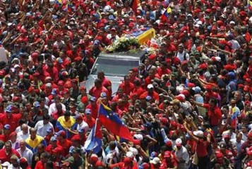 The coffin of Venezuela's late President Hugo Chavez is driven through the streets of Caracas after leaving the military hospital where he died of cancer, in Caracas March 6. Photo: Reuters