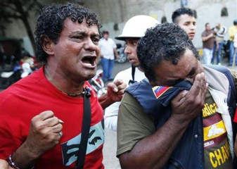 Supporters of Venezuela's President Hugo Chavez react to the announcement of his death in Caracas March 5, 2013. Photo: Reuters