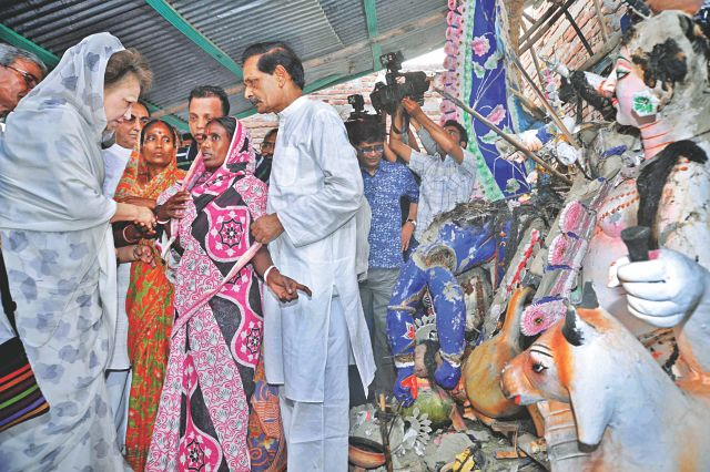 BNP Chairperson Khaleda Zia talks to local Hindus at Goalimandra Kali Mandir, vandalised by religious bigots in Munshiganj on March 3, during a visit yesterday. Photo: Star