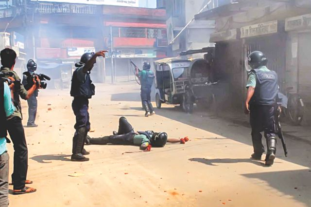 Armed Shibir cadres in action during a clash in Rajshahi yesterday. Photo: Star