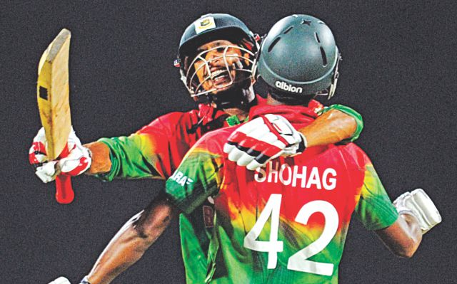 Nasir Hossain (L) and Shohag Gazi start an unbridled celebration for Tigers in the Lions' den yesterday. Photo: AFP