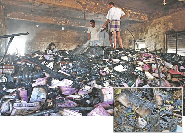 Heaps of burnt down school textbooks in the storehouse of Banshkhali Upazila Parishad in Chittagong, which was torched by Jamaat-Shibir on last Thursday. Inset, documents reduced to ashes following an arson attack on a civil court in the upazila the same day.  Photo: Star