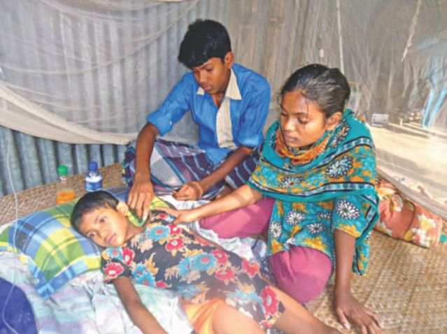 Seven-year-old Nargis Akhter, affected with a mysterious disease, is being given saline solution at their house at Hafeznagar in Shibalaya upazila of Manikganj. The unknown disease claimed the lives of her parents recently. Photo: Star