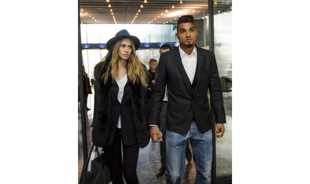 AC Milan's Ghana international Kevin-Prince Boateng (R) and his girlfriend Melissa Satta leave the FIFA headquarters in Zurich yesterday.  Photo:  AFP