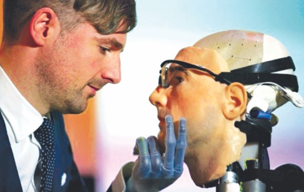 Researcher Bertolt Meyer, a lifelong user of prosthetic technology and the model for 'Rex', the world's first 'bionic man', poses with the humanoid at the Science Museum in London.