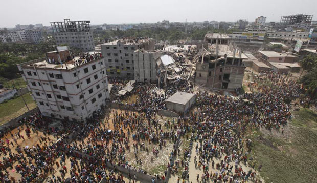 This April 24 photo shows, locals gather at the tragic sight in Savar where at least eighty people were killed in a building collapse.