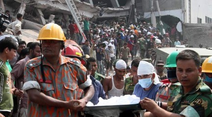 In this April 25 photo, rescuers are seen bringing a body recovered from debris of the collapsed building in Savar on the outskirts of the capital.