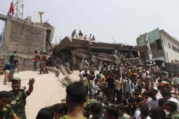 Rescue efforts go on after a nine-storied building housing five garment factories in Savar collapsed Wednesday morning. Bodies of at least 100 people have been recovered and 600 have been learnt to be hurt. Photo: Palash Khan