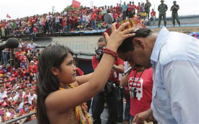 Maduro invokes curse on  opposition voters
