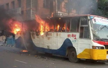 A bus goes up in flames after miscreants set it on fire near the capital's Kakrail intersection on Sunday. Photo: STAR