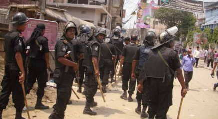 Rab men are on guard at Ganginarpar in Mymensingh town after Hefajat-e Islam activists clashed with ruling Awami League men during the ongoing hartal. 20 people hurt in the clash. Photo: STAR