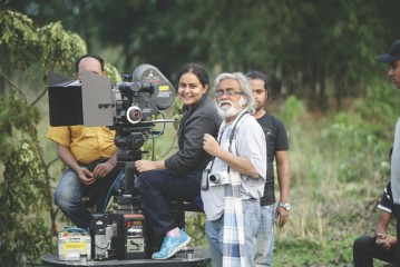 Afsana Mimi behind the camera, with cinematographer Anwar Hossain.