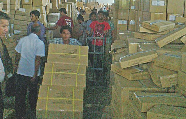 Boxes filled with clothes pile up at Shahjalal International Airport as the export-oriented garment industries opt for air to ship their cargoes instead of the traditional shipment via sea. Frequent hartals have forced many factories to switch to expensive air freight. Photo: Shariful Islam
