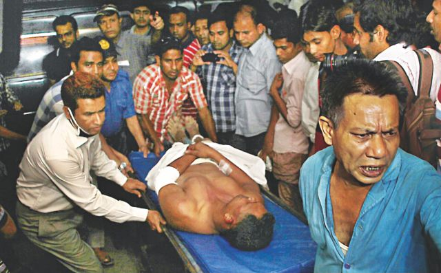This April 11 photo shows a man, who was injured in a clash between Hefajat-e Islam and Awami League activists at Kalirhat of Fatikchhari, is being brought to Chittagong Medical College Hospital. A person was killed and 50 others were injured in the clash during hartal hours.