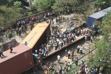 A man dies as two compartments of a freight train derail and fell on a slum adjacent to the rail tracks in the capital's Mohakhali area Thursday afternoon. Photo: Amran Hossain