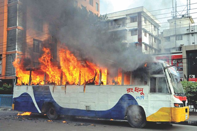 A bus set ablaze at the capital's Kakrail yesterday afternoon, on the eve of the daylong hartal of Hefajat-e Islam. The BNP-led 18-party alliance has also called a 36-hour hartal starting tomorrow. Photo: Courtesy