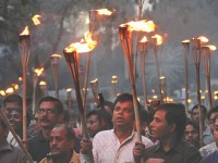 Activists of 23 organisations bring out a torch procession yesterday evening denouncing the long march.  Photo: Star/ Focus Bangla