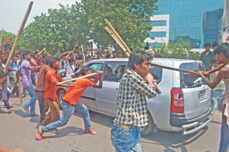 Garment workers go berserk in front of BGMEA Bhaban in the capital, as the authorities did not declare yesterday a holiday to mourn the victims of the Savar tragedy. Yesterday was declared a day of national mourning. Photo: Star