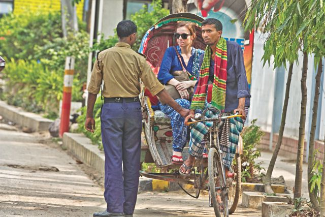 A lungi clad rickshaw puller stopped at the entry of Baridhara in the capital yesterday. Security workers do not let rickshaw pullers in lungi into the posh neighbourhood following instructions from the association of Baridhara home owners. Photo: Star