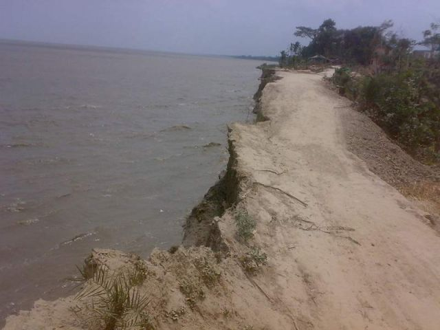 Vast tract of cropland and houses got flooded following damage to the ring embankment at Purbo Keyamullah in Chandpur union of Tazumuddin upazila of Bhola district under the impact of the strong current of the Meghna River during the high tide on Sunday afternoon.   PHOTO: STAR