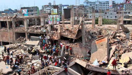 Rescuers continue frantic effort to bring out those trapped inside the rubble of the Savar building that caved in Wednesday. Star photo.