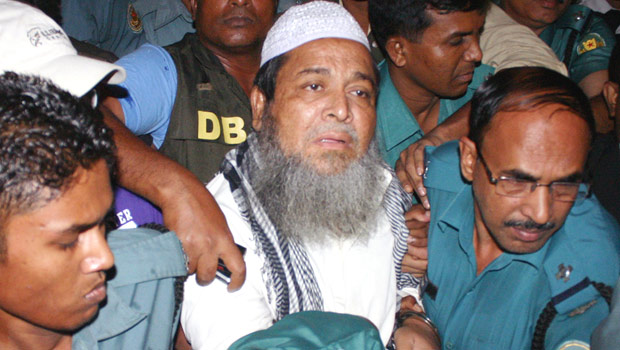 This May 7 photo shows law enforcers taking Hefajat-e Islam Secretary General Junaid Babunagari to a court in the capital. Star file photo