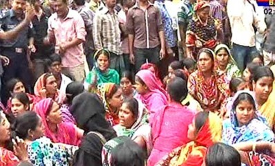 Workers at five garment factories housed in the collapsed Rana Plaza block Dhaka-Aricha highway in Savar bazaar bus stand area Tuesday morning demanding their arrears. Photo: TV grab