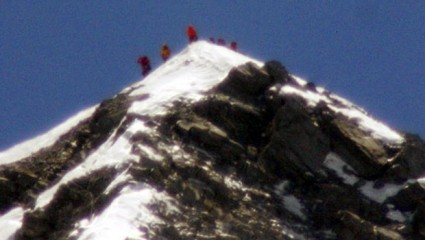 A team of climbers led by 80-year-old Japanese mountaineer Yuichiro Miura stand on the summit of Mount Everest on Thursday, May 23, 2013. Miura on Thursday became the oldest man to reach the top of Mount Everest, a Nepali official and Miura's Tokyo-based support team said. Photo: AP