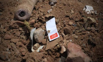 A clothes tag lies in the rubble of a garments factory that collapsed in Savar near Dhaka, Bangladesh, Friday, May 3. Photo: AP