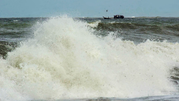 A boat goes for safer place Wednesday afternoon as the sea sees rough tide with Cyclone Mahasen approaching Bangladesh coastal region. Photo: Focus Bangla
