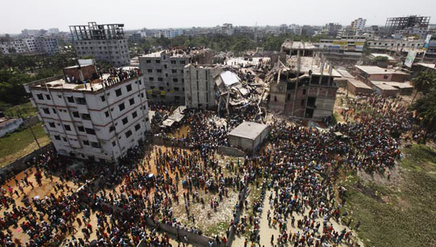This April 24 photo shows locals gathering near the collapsed Rana Plaza. Total 2,438 survivors were rescued and 1,127 bodies pulled out from the wreckage.
