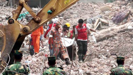 This May 10 photo shows rescuers carrying a body recovered from the rubble of the collapsed Rana Plaza at Savar. The nine-storey building collapsed on April 24.