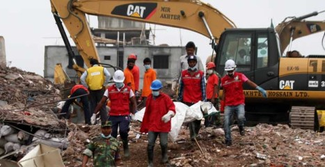 This May 6 photo shows rescuers carrying a body recovered from the rubble of the collapsed Rana Plaza at Savar, an outskirt area of the capital. The nine-storey building collapsed on April 24.