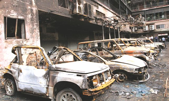 The wreckage of parked cars at House Building in Motijheel yesterday. They were all burnt on Sunday during the Hefajat-e Islam rampage in the area. Photo: Amran Hossain