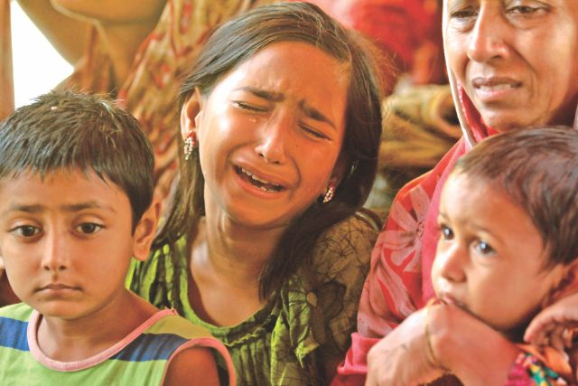 """Have the rice I cooked and feed your brother and sister too"" is the instruction Sabina received from her mother Mita as she rushed to work on April 24 morning. In the photo Sabina is seen in tears among her siblings and grandmother yesterday when her mother's body was identified 19 days after Rana Plaza collapsed in Savar. Photo: Sk Enamul Haq"