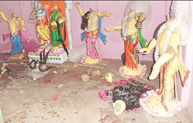 Century old idols of a Krishna temple at Kuleshwari Bari in Hossainpur of Kishoreganj lay in ruins after criminals attacked the temple Tuesday night. Photo: Banglar Chokh