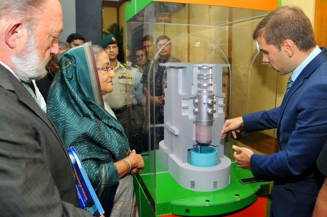 "Prime Minister Sheikh Hasina inspects the model of a nuclear power plant project during an international seminar, ""Nuclear Power: A Chance of Successful Economic, Social and Political Development"", at a hotel in the capital yesterday. The programme was organised in cooperation with Russian Federation and International Atomic Energy Association (IAEA) to create awareness among people about nuclear energy. Photo: BSS"