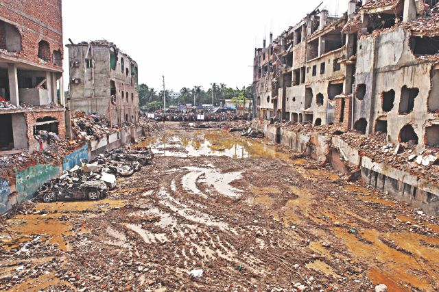 On this soil at Savar stood the nine-storey Rana Plaza, which came crashing down three weeks ago, causing heavy casualties. The site looks like plain land yesterday, completely devoid of any life. Photo: Rashed Shumon