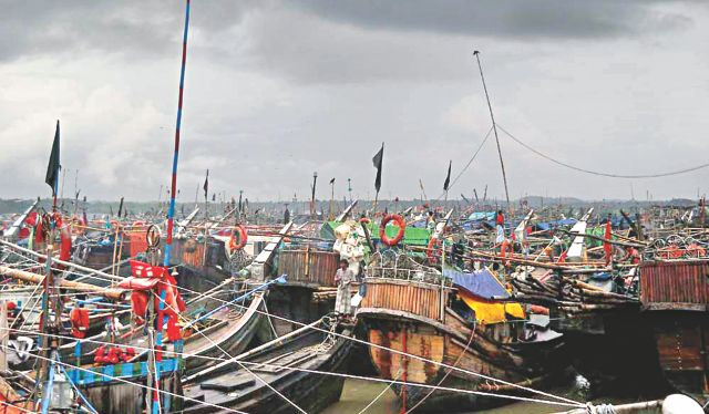 Fishing boats are anchored on the coast in Cox's Bazar, coming back from the Bay with cyclone Mahasen slowly moving towards the country and the Met office issuing danger signal-IV yesterday.    Photo: Focus Bangla