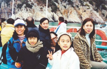 Kim (left) with her sister and their families.