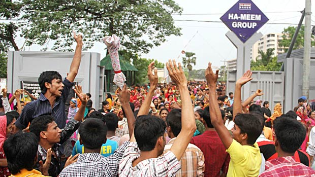 Thousands of garment workers come out to the streets demanding a hike in their salaries at Ashulia of Savar on Monday. Photo: Focus Bangla