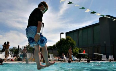 A boy jumps into a pool, Wednesday, July, 11, 2007, in Seattle. Records for heat were set at Seattle-Tacoma International Airport, in Olympia and in Bellingham.  Photo: AP