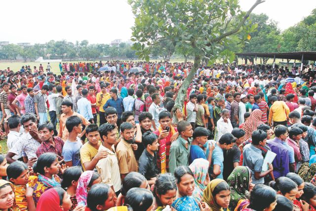 Surviving workers gather on the shooting field of Savar Cantonment to collect their salaries to be disbursed by BGMEA. Photo: Anisur Rahman