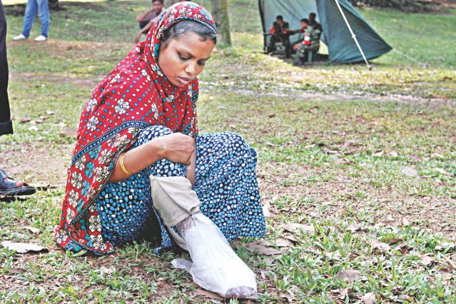Rita came to Savar Cantonment to get her salary with a broken leg since the everyday concern of the low wage garment workers is how to subsist. Photo: Anisur Rahman