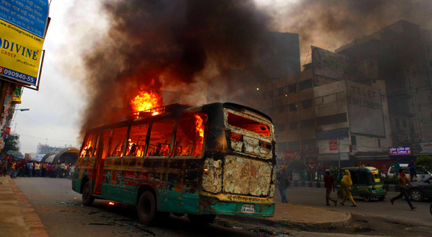 Pro-hartal activists torch a bus on the Kazi Nazrul Islam Avenue in Karwan Bazar in the capital on Tuesday. At least six vehicles were set to fire ahead of opposition alliance countrywide shutdown on May 8 and 9. Photo: Rashed Shumon