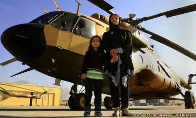 "Col Latifa Nabizada, the first female pilot of Afghanistan, often shares her cockpit with her daughter. ""She has grown up in a helicopter,"" she says. Photo: BBC Online"