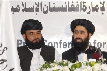 Muhammad Naeem (R), a spokesman for the Office of the Taliban of Afghanistan speaks during the opening of the Taliban Afghanistan Political Office in Doha on June 18, 2013. Photo: Reuters