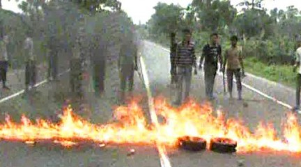 Pro-hartal pickets set fire to tyres on a road in Seujgari area of Bogra town Monday morning during a countrywide dawn-to-dusk hartal (shutdown) enforced by Jamaat-e-Islami. Photo: TV grab