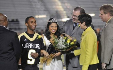 Oak Grove High School principal Wayne Folkes crowns senior Paromita Mitra (cq) the 2008 homecoming queen as she was escorted by Mico Bivens (cq) who is a senior defensive back on the football team. Photo: hattiesburgamerican.com